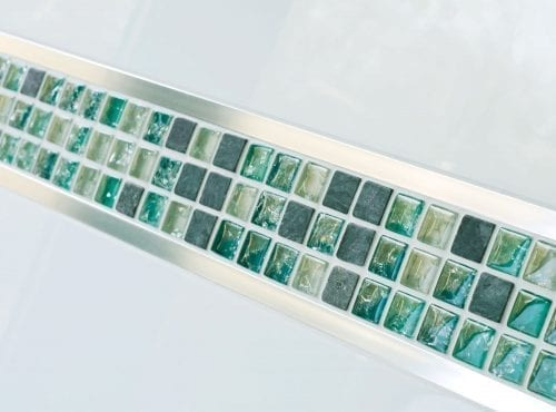 Green mosaic tile with metal tile trim