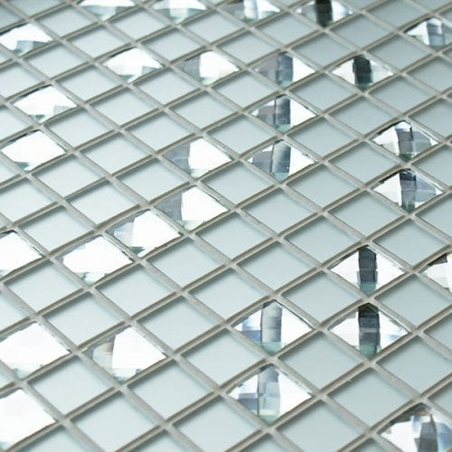 Glass mosaic tiles with mirror and diamond cut glass pieces.
