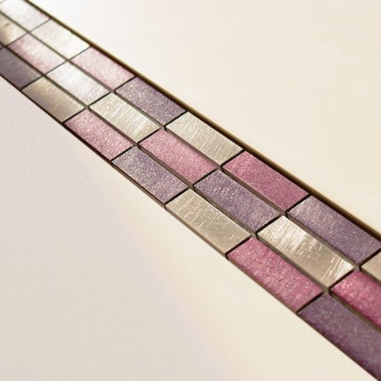 Pink and purple metal and glass mosaic border tiles
