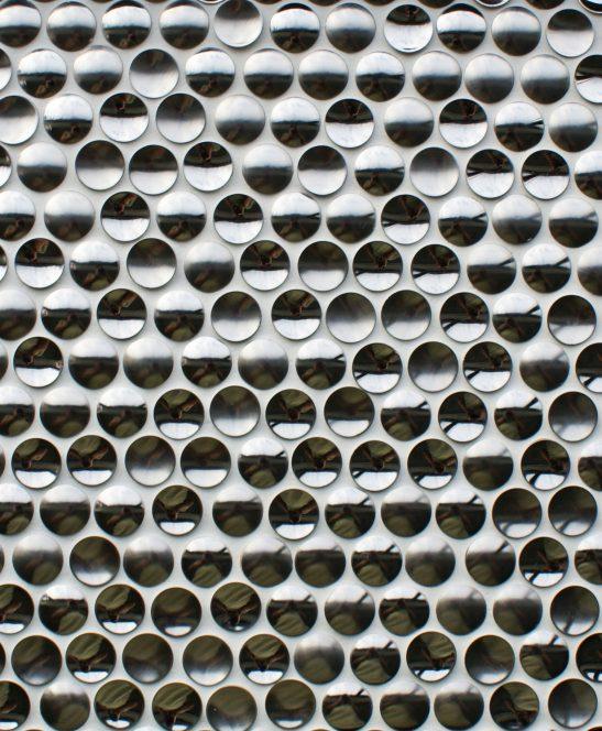 Orbital chrome mosaic tile